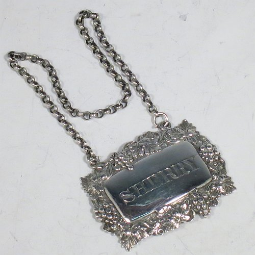 An Antique Victorian Sterling Silver wine decanter label, having a shaped rectangular body, with applied grape and vine-leaf border, hand-engraved for Sherry, and with its original bottle chain. Made by Joseph Wilmore of Birmingham in 1840. The dimensions of this fine hand-made antique silver decanter wine label are height 3.5 cms (1.3 inches), length 4.5 cms (1.75 inches), and it weighs approx. 12g (0.38 troy ounces).