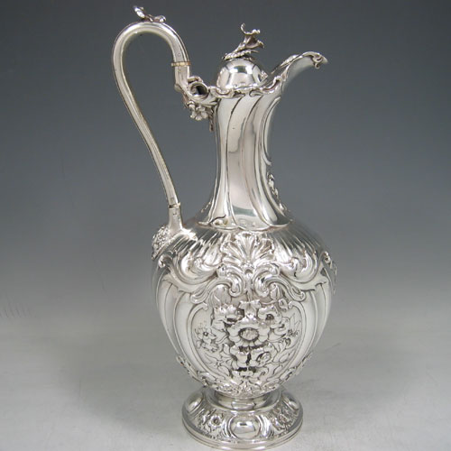 Antique Victorian sterling silver hand-chased wine ewer made by Charles Reilly & George Storer of London in 1845. Height 33 cms, width 13.5 cms. Weight 29 troy ounces.