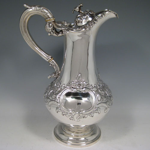 Antique Victorian sterling silver large hand-chased wine ewer made by Leon'd Urquart of Edinburgh in 1837. This item has an insulated handle so can be used for hot liquids if required. Height 30 cms (12 inches), length 20 cms (8 inches). Weight approx. 36 troy ounces (1,116g).